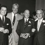 Sidney Colby, guest Caesar Romero, & Ben B. Bodne in Algonquin lobby